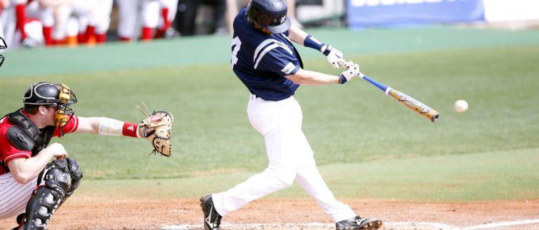 A baseball batter swinging his bat at an incoming pitch.
