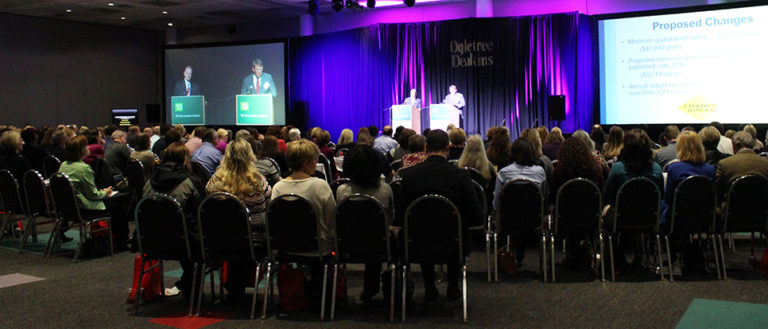 Conference attendees focusing their attention to the TD Convention Center stage.