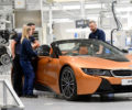 Factory workers assembling the BMW i8 Roadster.