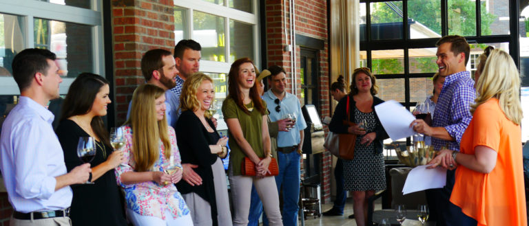 A group of young professionals at a Meals on Wheels event.