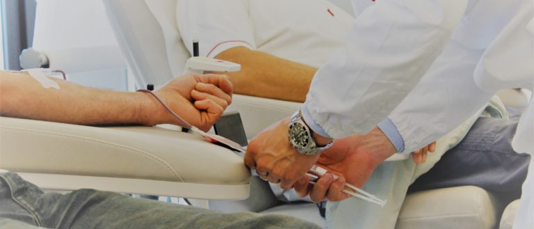 A person giving blood at a donation drive.