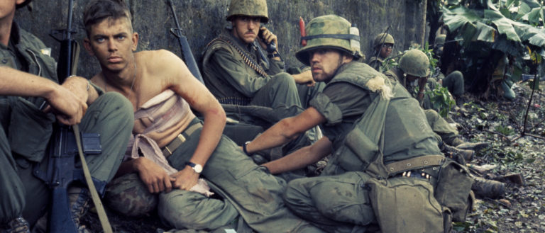 A group of American soldiers resting after battle.
