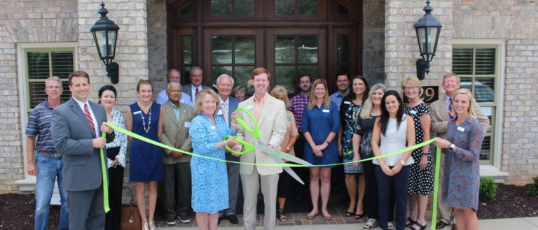 A ribbon cutting for the Susan E. Crocker Human Resources Consulting merger.