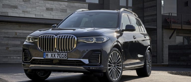 The BMW X7 outside of a modern home.