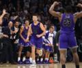 The Furman University men's basketball team celebrating during a win against Villanova.