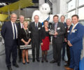 HTI receiving the Michelin Global Supplier of the Year award.