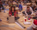 Clemson student wrapping holiday gifts.