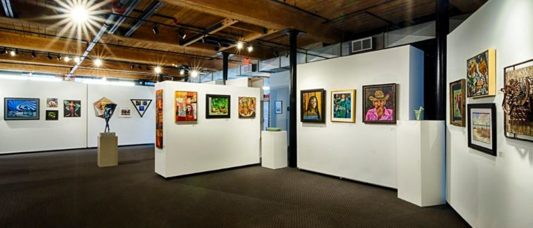 The GCCA gallery floor during a member show and a Brandon Fellows exhibition.