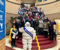 Greenville County Schools employees with the Michelin mascot.