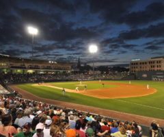 Fluor Field featuring a Greenville Drive baseball game at night.