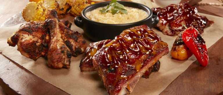A plate of barbeque and side dishes.