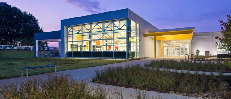 The exterior of a lit Five Forks Library at night.