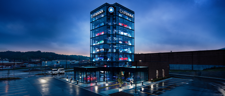 "A Carvana retail location featuring a large ""vending machine."""