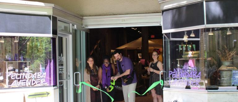 Pelindaba Lavender Greenville employees holding a ribbon cutting.
